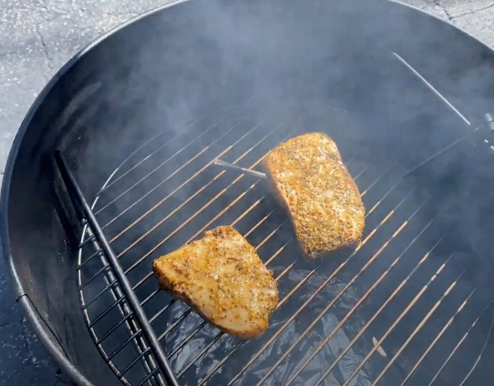 smoked swordfish steaks cooking in a smoker