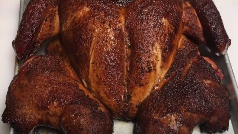 a spatchcock turkey smoked on a pellet grill
